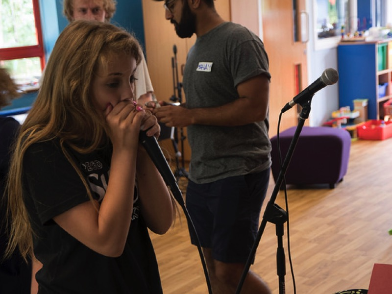 Photo of young person recording her song as part of Pedestrian's Concept project.